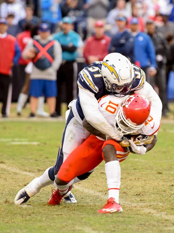 Jan. 1, 2017 - San Diego Chargers rookie linebacker Jatavis Brown tackled Kansas City Chiefs wide receiver Tyreek Hill in the open field late in the fourth quarter in San Diego, CA. By; John Moore/Locker-Report.com
